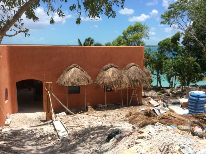 The palm frond overhangs protect from sun and rain. They will be completed is week.