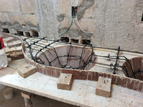 Creating the mold for a poured concrete bathroom sink.